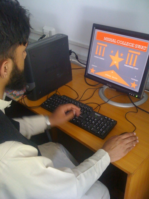 Arshad working on a computer at Mishal Rehab Facility